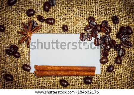 White visiting card with coffe, cinnamon and star anise on burlap - stock photo
