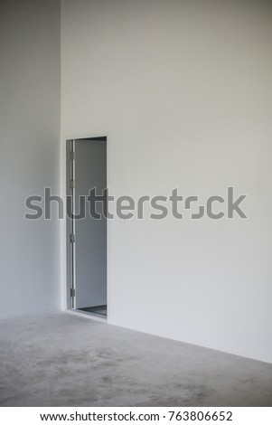 White wall and door in Cement room
