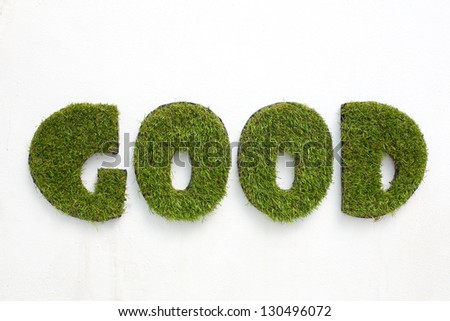White wall and good green grass - stock photo