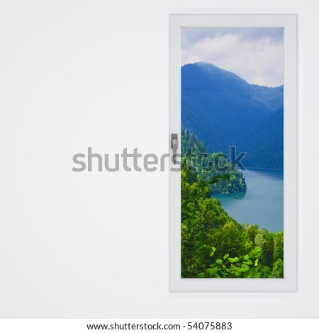 white wall and window with a beautiful view on mountains and lake - stock photo