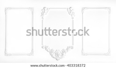 White wall decorated with stucco and molding in the style of Renaissance, Baroque. - stock photo
