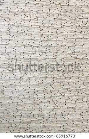 White wall made from small marble tiles - stock photo