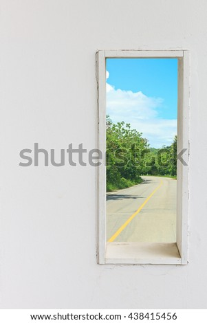White wall window with street in nature view, vertical landscape concept background.