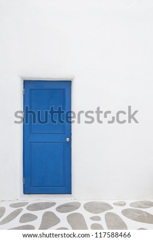 White Wall With Blue Door - stock photo