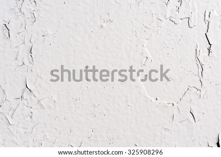 White wall with cracked paint on the background - stock photo