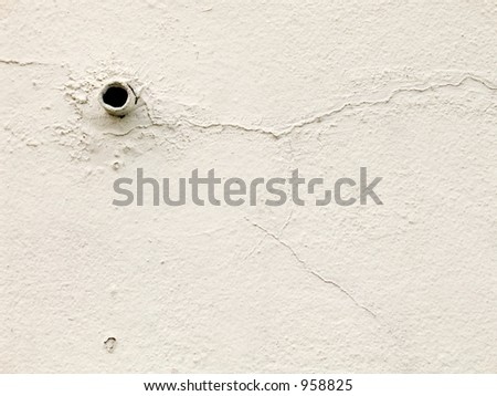 White wall with hole - stock photo