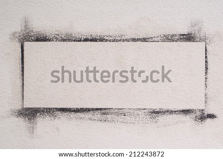 white wall with painted frame. Background - stock photo
