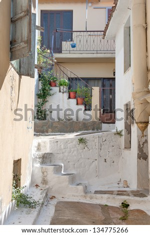 White washed alley way in a Greek village - stock photo