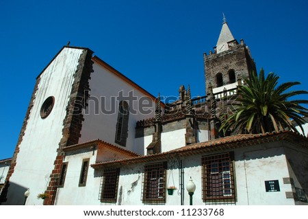 White washed and red tiled church in Funchal, Madeira Islands - stock photo