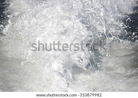 White water, churning sea shot with high shutter speed to freeze action. - stock photo