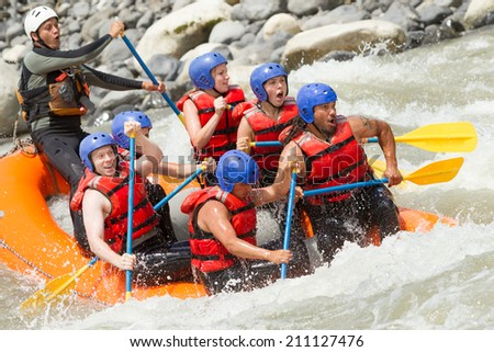 WHITE WATER RAFTING TEAM IN BRIGHT SUNLIGHT, PASTAZA RIVER, ECUADOR, SANGAY NATIONAL PARK   - stock photo
