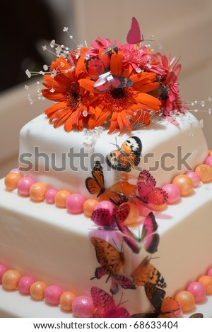 White wedding cake closeup with red and pink flowers - stock photo