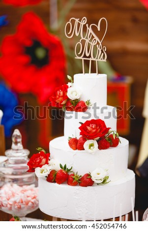 White wedding cake with flowers and fruits