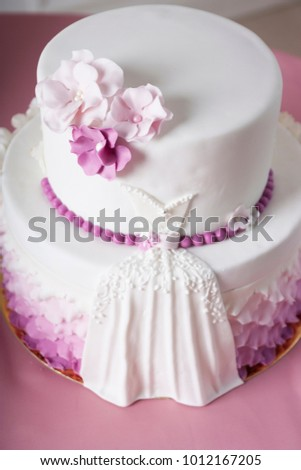 White wedding cake purple pink flowers stock photo edit now white wedding cake with purple and pink flowers is on a pink tablecloth mightylinksfo