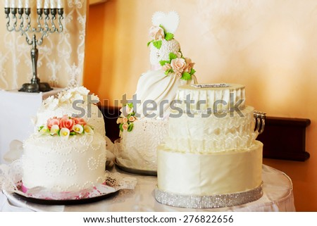 white wedding cakes on a table Kosher Menorah