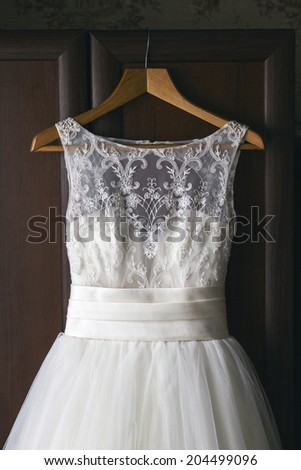 White Wedding dress on a shoulders, before ceremony - stock photo