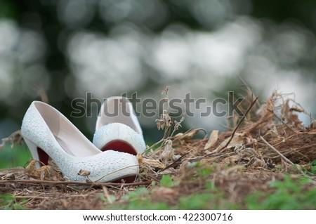 White wedding shoes for women. malay wedding. selective focus - stock photo
