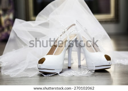 white wedding shoes with accessories - stock photo