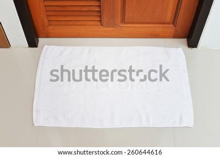 white welcome doormat - stock photo