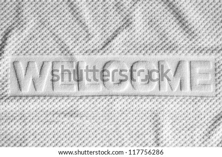 White welcome mat made from fabric - stock photo