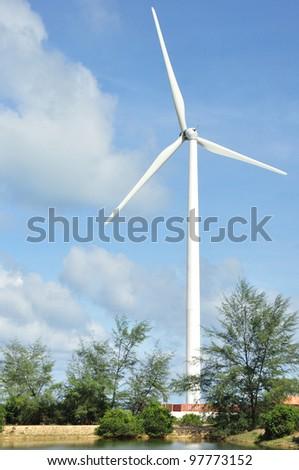White wind turbine electric power generator station - stock photo