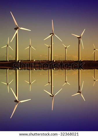 white wind turbines in the top of the mountain - stock photo