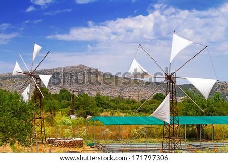 White windmills of Lasithi Plateau on Crete, Greece - stock photo