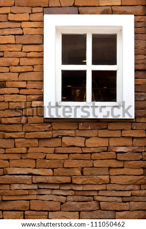 white window in a old brick wall - stock photo