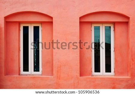 White window on light red grunge wall background - stock photo