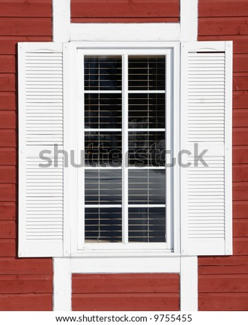 White window on red wall