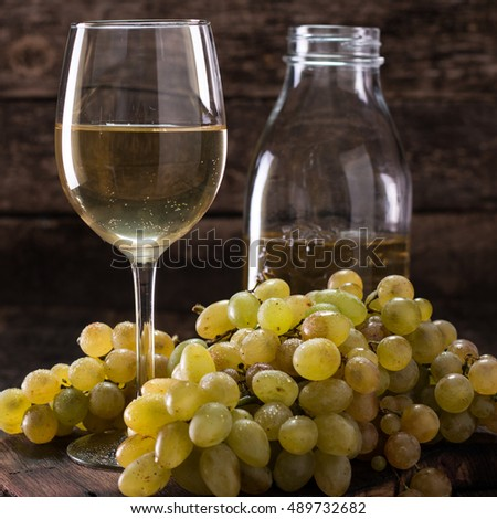 White wine and grapes/ Wine and grapes on vintage wooden table