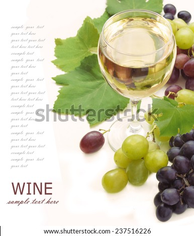 White wine and grapes with fresh leaves isolated on white background with sample text