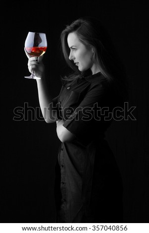 white wine and strawberries in a crystal glass - Girl and strawberries - beautiful young brunette with big breasts posing with a red fresh organic strawberries seductive sexy looking into the camera - stock photo