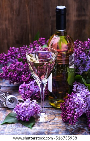 White wine bottle lilac flowers on stock photo royalty free white wine at the bottle with lilac flowers on wooden background mightylinksfo