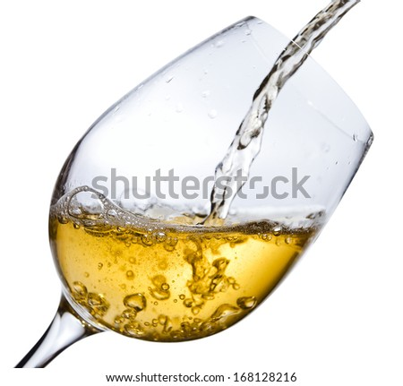 White wine being poured into a wineglass, isolated  on white ,saved clipping path