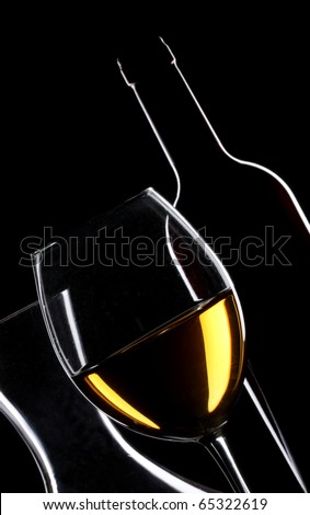 White wine bottle and glass silhouette over black background