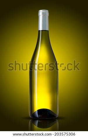 White wine bottle on yellow background