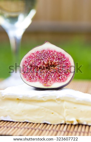 White wine, brie cheese and figs (shallow depth of field)