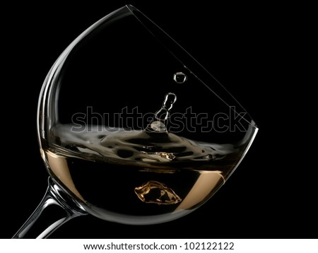 White wine drop in a glass - stock photo