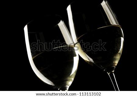 white wine glass silhouette black background - stock photo