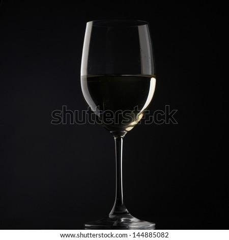 white wine glass silhouette white background - stock photo