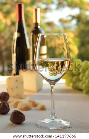white wine in a glass on food background - stock photo