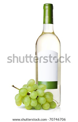 White wine in bottle with blank label and grapes. Isolated on white background