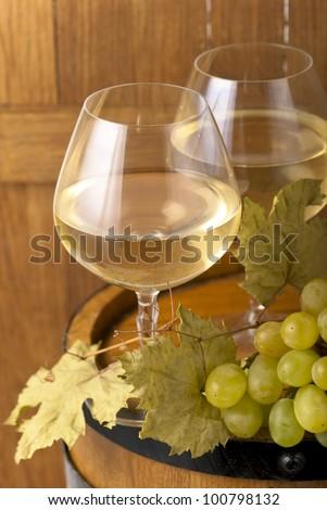 White wine in fine glass  and grape - stock photo