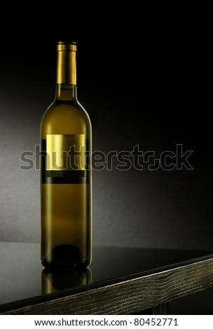 white wine on black table - stock photo