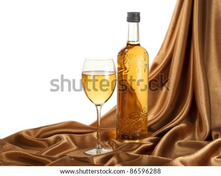 White wine on golden silk - stock photo