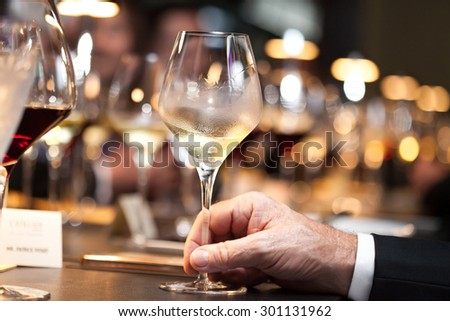 white wine on hand with dinner on restaurant - stock photo