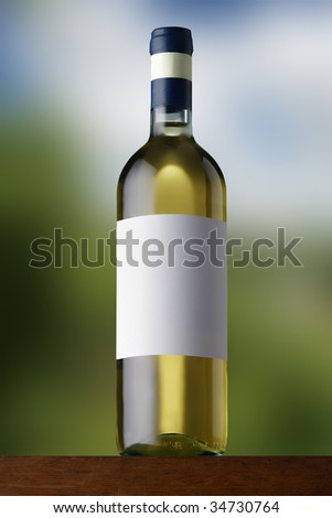White wine on soft background - stock photo