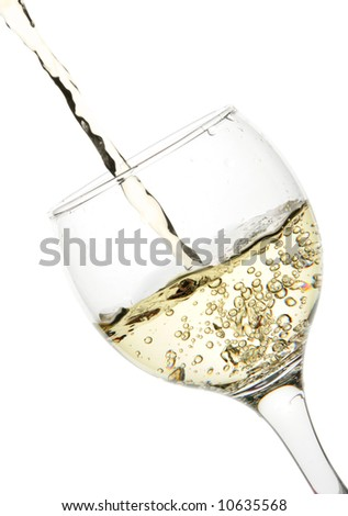 White wine pour into glass close-up isolated over white background