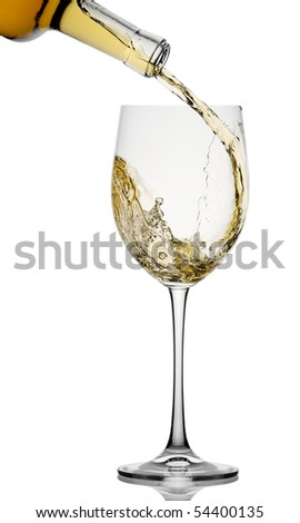 White wine poured in a glass isolated on a white background - stock photo